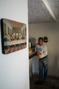 "48-year-old Sergio Ceballos Ascensio is seen inside the house of 54-year-old Maria Emma Mora Liberato, they work together at the NGO ""Familias de Acapulco en busca de sus desaparecidos"". Sergio's 17-year-old stepdaughter Monserrat Smith Orozco was kidnapped on the street on 9 August 2015. She was then found dead in 2018. Supported by an international project promoted by the AVSI foundation and financed by the EU, local NGOs are trying to change their future. Acapulco, Mexico 2019. © Matteo Bastianelli"