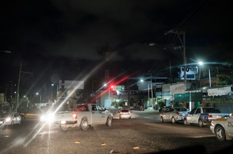 Mexican Marines are seen on a pick-up patrolling the streets of the city center at night. Since the beginning of the Mexican Drug War in 2006, the Mexican government has been fighting drug traffickers, who have fought each other at the same time for the control of the territory. This widespread violence has claimed more than 250,000 lives so far. Acapulco, Mexico 2019. © Matteo Bastianelli