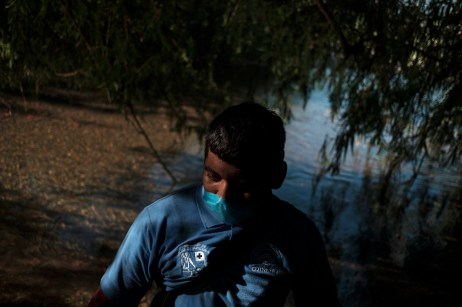 Alejandro Cruz Barragan, a student of professional career in community health at CONALEP, is seen by the local river during the cleanliness activities of the area from plastic, agrochemical empty bottles and waste generated by nearby cultivators. Santiago Huajolotitlán, Mexico 2019. © Matteo Bastianelli