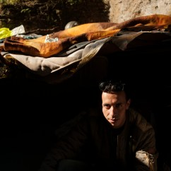 23-year-old Moroccan migrant Charaf Ait Haba, portrayed in the makeshift shelter where he currently lives with other 4 people, inside an area that has been fenced due to the process of securing and restoration started in 2019 and stopped following the pandemic outbreak. Despite the danger of collapse, many homeless currently live near the Aurelian Walls, in the vicinity of the Termini station, during Italy's lockdown aimed at stopping the spread of coronavirus. Rome, Italy, April 2020. © Matteo Bastianelli/National Geographic Society Covid-19 Emergency Fund