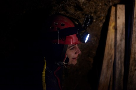 "Carol Laly Michel, a speleologist who works for the french team for research ""Nord Sud Institute"", is seen before an immersion in a water flow discovered inside the Ravne tunnel. Visoko, Bosnia and Herzegovina, 2014. © Matteo Bastianelli for Discovery Communications"
