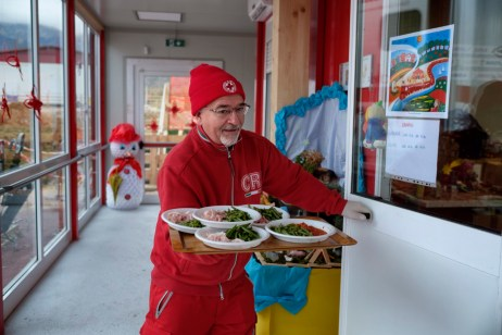 A Red Cross volunteer is seen bringing meals to the students of the Romolo Capranica Institute. Amatrice, Italy 2016. © Matteo Bastianelli
