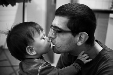 Adis Smajić, sweetly gives the pacifier to his son Alen. Sarajevo, Bosnia and Herzegovina, 2014. © Matteo Bastianelli