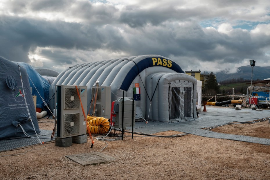 A Civil Protection social and health station (PASS) set up inside a tent at the Lazio Camp. Amatrice, Italy 2016. © Matteo Bastianelli