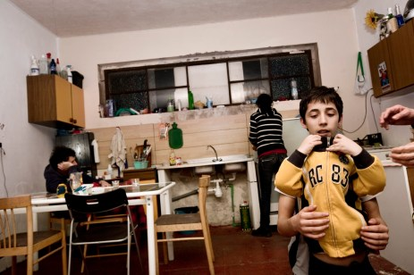 """A moment for recreation inside one of the apartments in """"Casale de Merode"""". Rome, Italy 2009. © Matteo Bastianelli"""