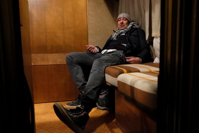 50-year-old Romeo Tilesi is seen inside his caravan. Amatrice, Italy 2016. © Matteo Bastianelli