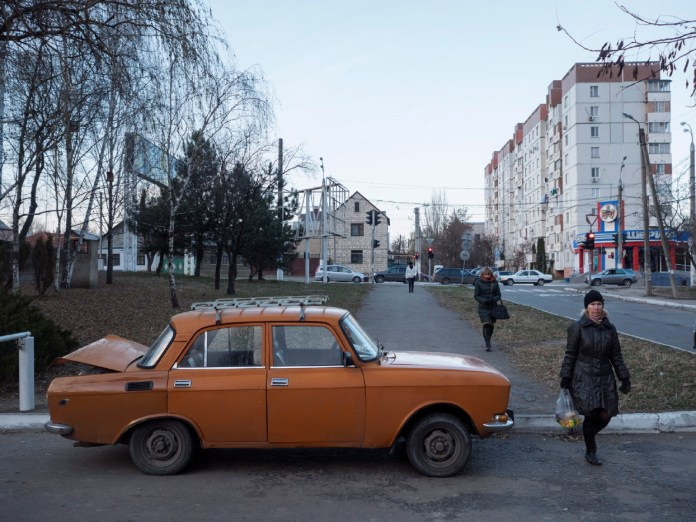 """A Moskvich 412, produced by the """"Leninist Communist Youth League Automobile Factory"""" (AZLK), one of the most popular models among Muscovite youths, parked on a downtown street. Tiraspol, Transnistria (Moldova) 2014. © Matteo Bastianelli"""