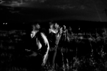 A group of Syrian asylum seekers walking through cultivated fields in order to reach the border between Greece and Slav-Macedonia, after border police had driven them back to Greece. Evzoni, Greece 2015. © Matteo Bastianelli