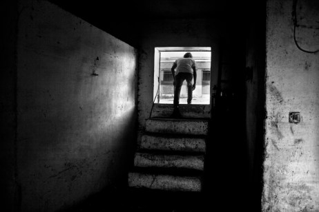 Vittorio Fornaro at work inside his farmhouse. He lost his mother to cancer and it was here, in 2008, that an order to slaughter around 700 animals that were infected with dioxin was carried out. Taranto, Italy 2013. © Matteo Bastianelli