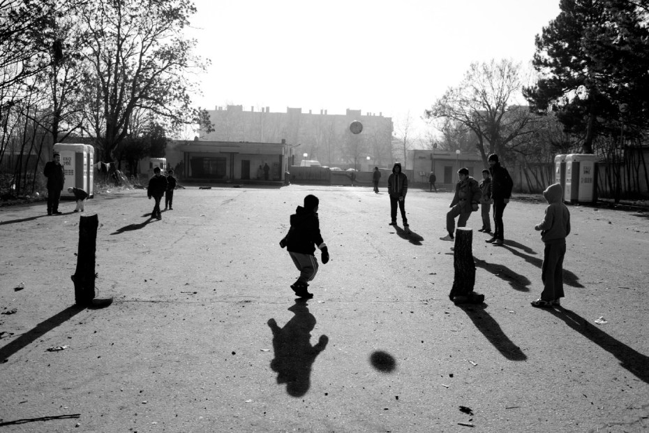 A football match on a makeshift field in the refugee camp where about 1,500 asylum-seekers are hosted. Most of them are Syrian Kurds, who irregularly entered Bulgaria across the border with Turkey. Harmanli, Bulgaria 2013. © Matteo Bastianelli