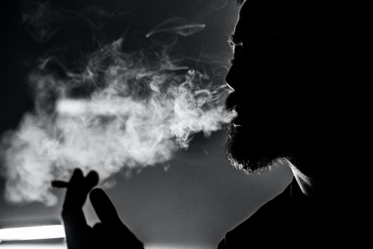 Man smoking a cigarette.