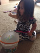 Emma slings her Easter gifts as she go through the bucket Uncle Matthew and Aunt Paige gave her.