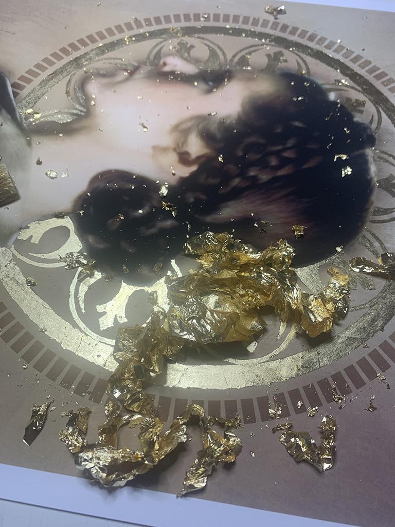 Aftermath of brushing up loose gold leaf on portrait.