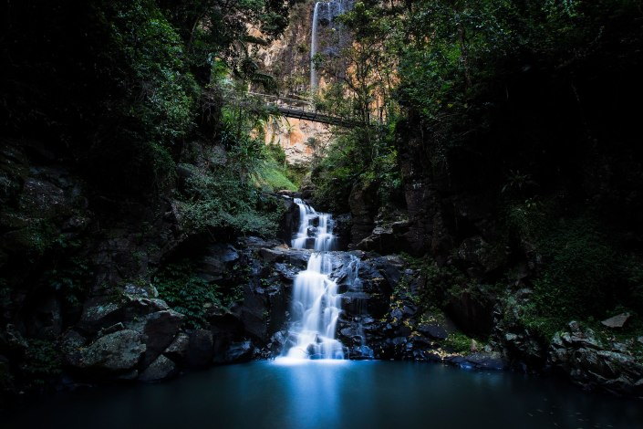 Long exposure of purling brook falls a huge waterfall in the gold coast hinterland