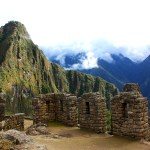 Machu Picchu at sunrise with a soft cloud cover