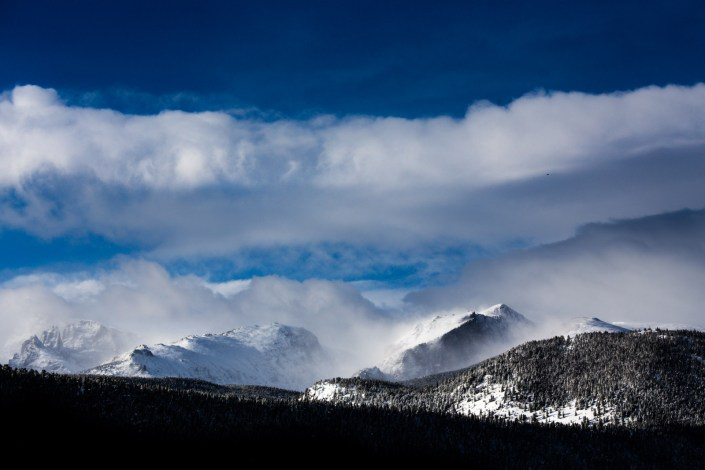 morning light with blue skies and fresh snow on the colorado rockies