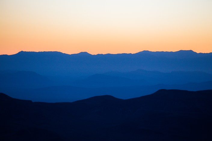 3 layers of coloured mountains from the sunset light