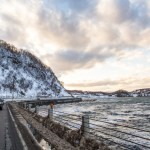 cars drive along the snowy seaside cliffs on the sea of japan