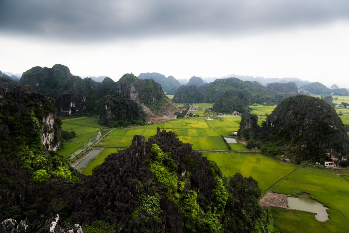 looking down on the rivers that flow between granite cliffs and rice paddies which is often considered the halong bay on land