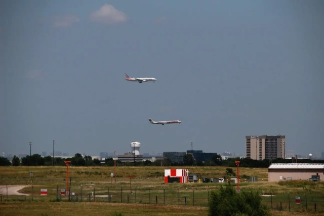 American MD-83 in the foreground, American 777 in the background. Both planes are landing into the south.