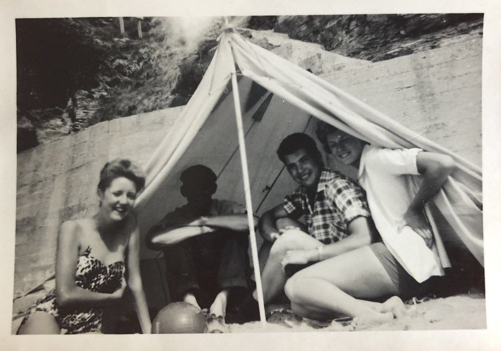 My parents and my mother's father in a tent on the beach, in the early 1960s