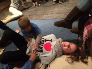 My niece, Hannah, being tormented with tickles by, among others, my nephew, Jordy. Yep, tormented with tickles. We're that kind of family.