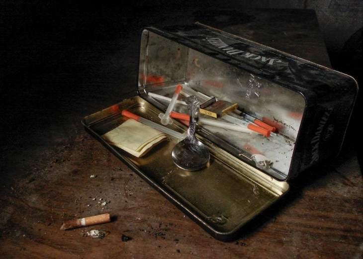 Heroin kit inside of a Jack Daniels tin box