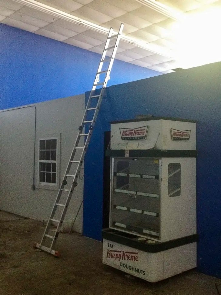 Ladder and a Krispy Kreme display in an abandoned Dance Studio