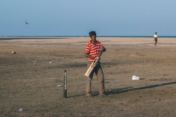 A man playing Cricket on Nagapattinam Beach