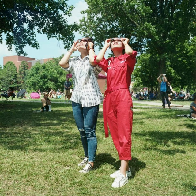 An analog portrait of two women watching the solar eclipse at SIU in Carbondale, Illinois