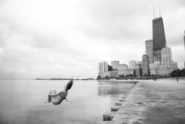 Girl jumping into Lake Michigan