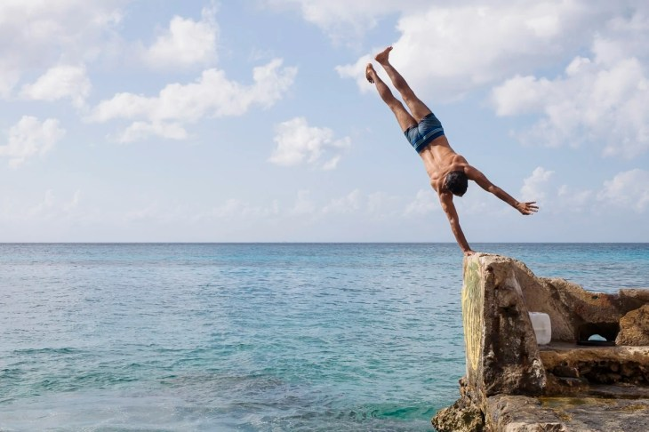 A guy doing a hand stand in Cozumel