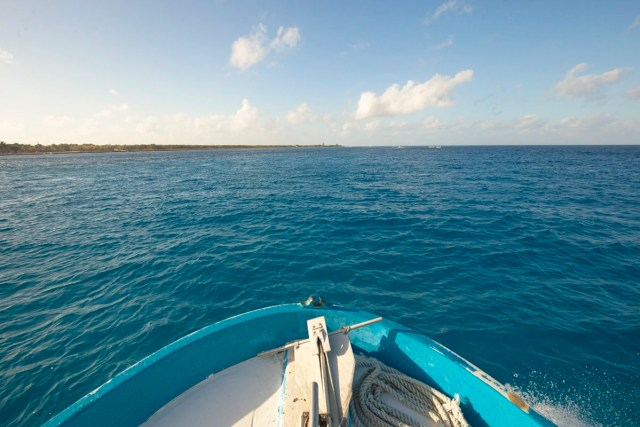 Riding boat out to dive location.