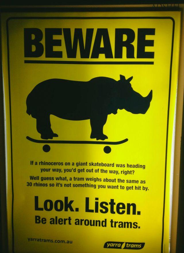 Yarra Trams Safety Poster, Rhino On a Skateboard. Look. Listen.