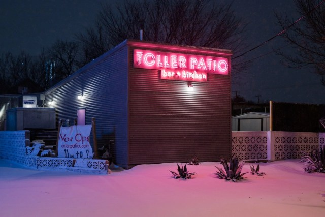 Toller Patio bar with their pink neon sign in the snow