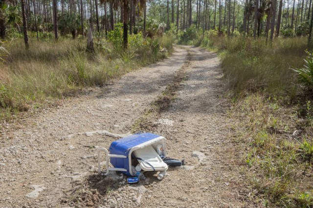 An abandoned cooler with Bud Light