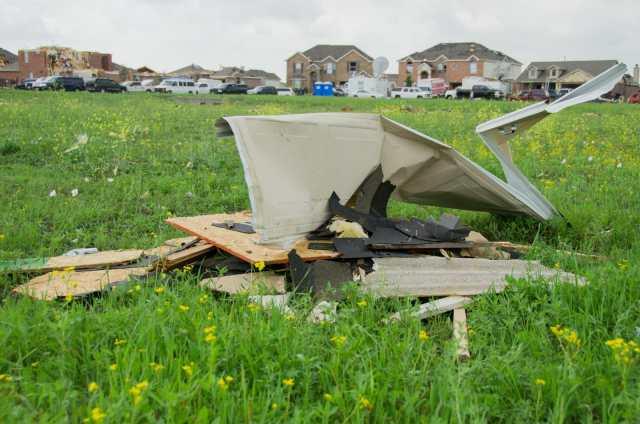 Debris left in a field by the tornado