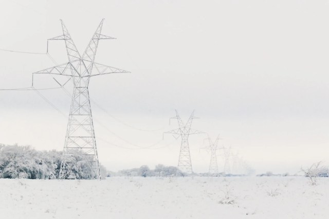 Transmission towers and power cables in snow