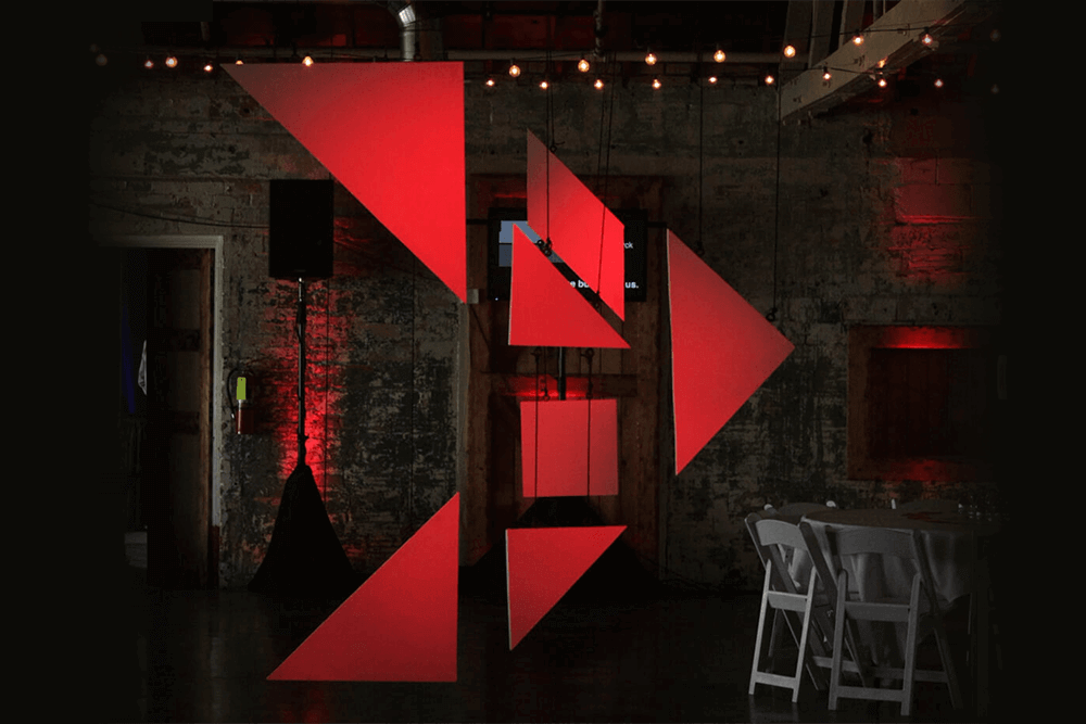 Tangram arrow hanging from ceiling at the OTA:Bismarck event