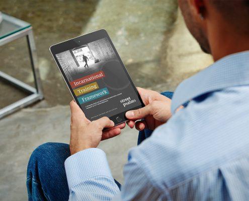 Man reading the Incarnational Training Framework ebook