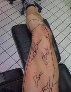 Penis on the leg tattoo