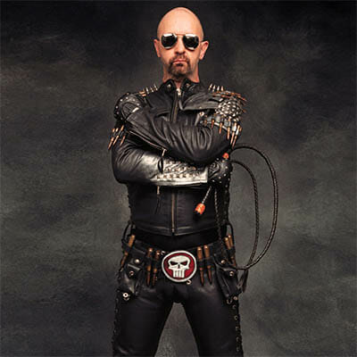 Rob Halford Gay Leather Daddy holding a whip