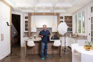 Portrait of real estate photographer in Glencoe kitchen.