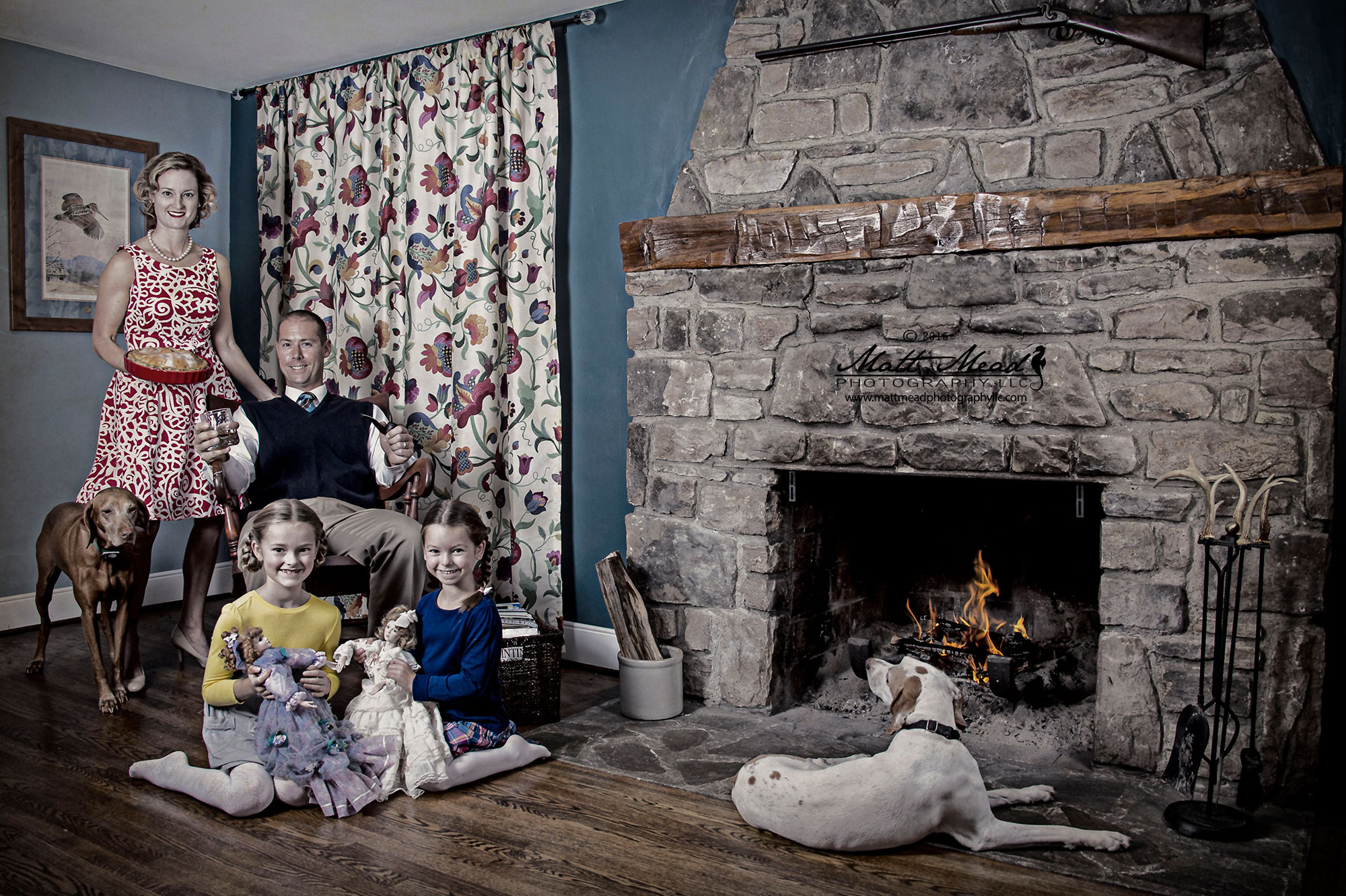 family gathers in front of fireplace for vintage family portraits session