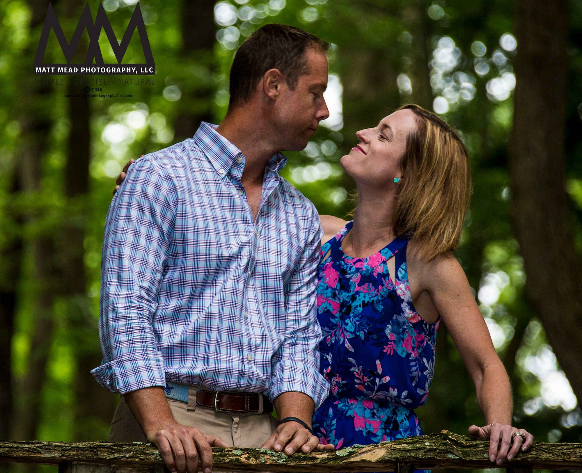 husband and wife smiling at each other during family portraits session in Ligonier, PA