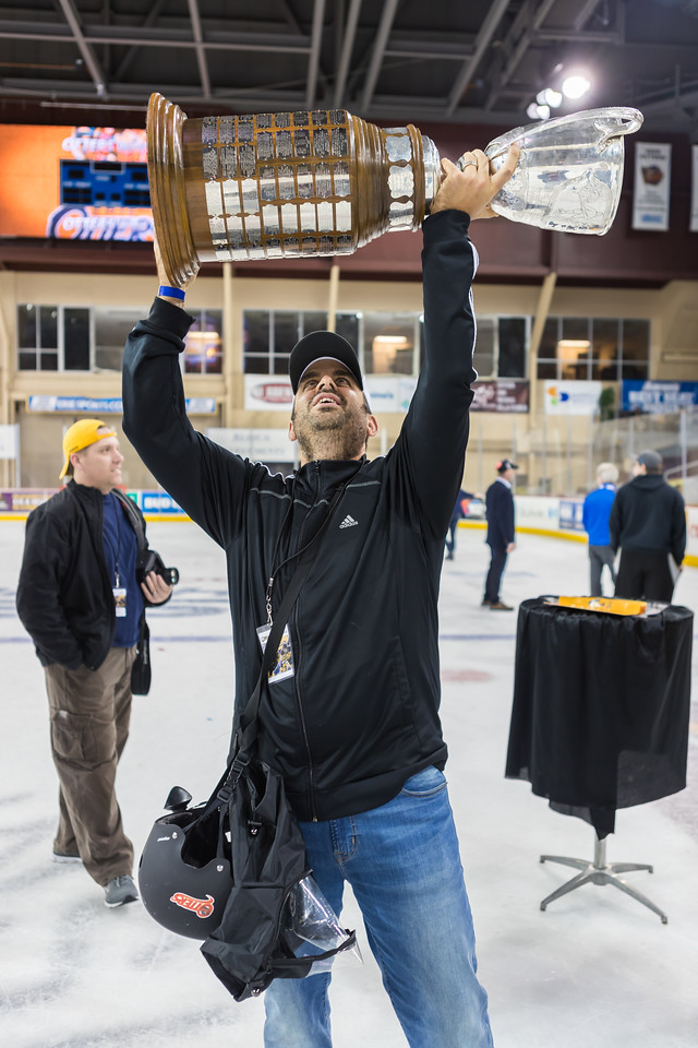 Matt Mead hoisting the Robertson Cup after Erie Otters victory