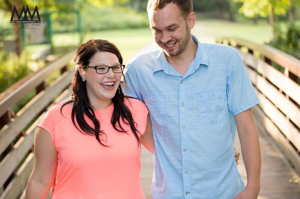 erie pa engagement laughing on a bridge photo