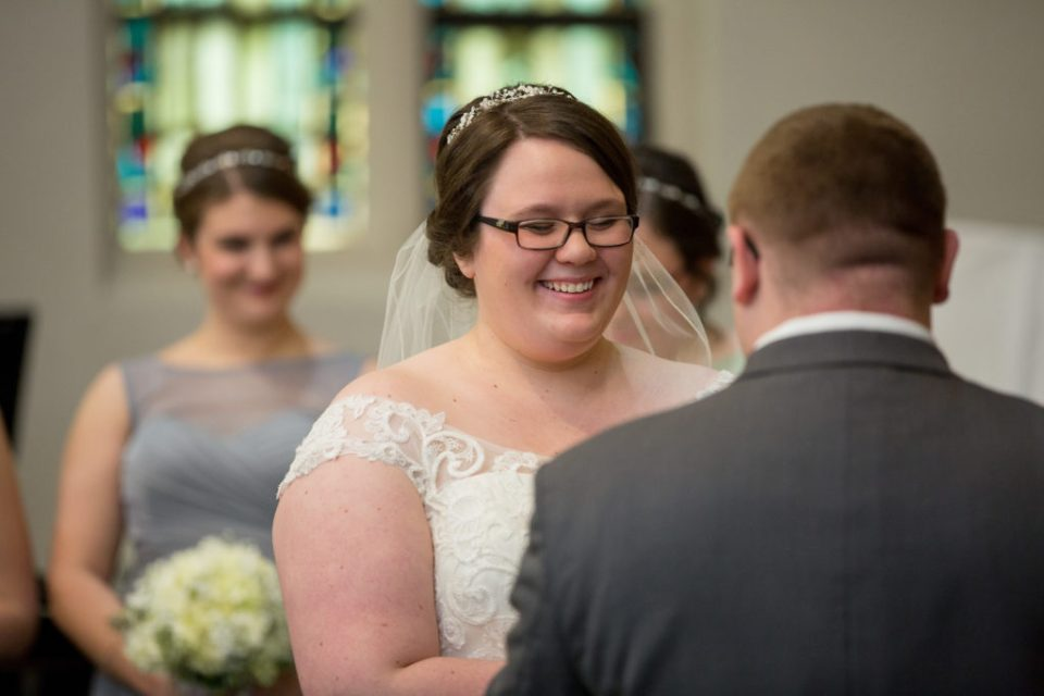 bride smiling during wedding vows in Erie, PA