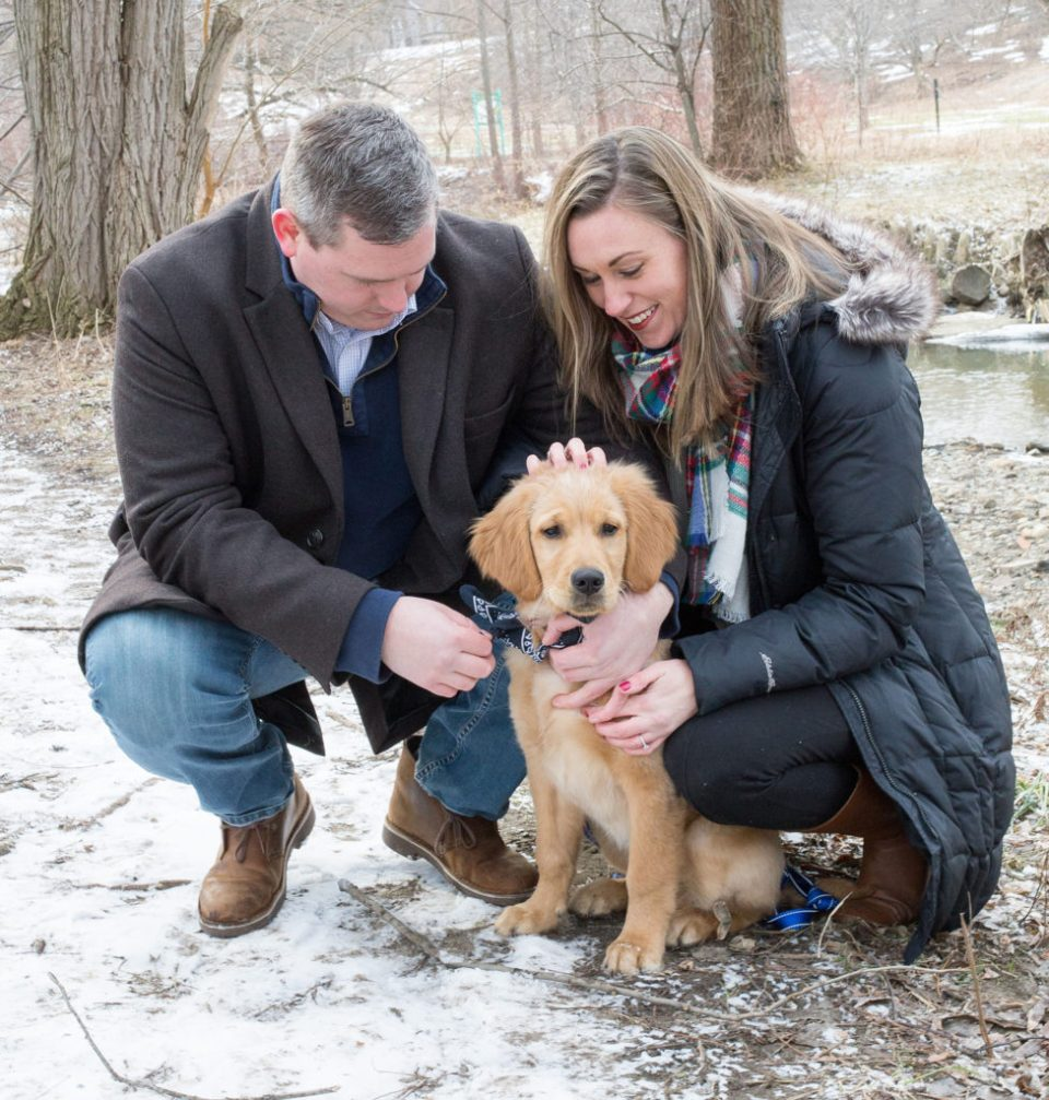 engaged couple and puppy during engagement session at Frontier Park in Erie, PA
