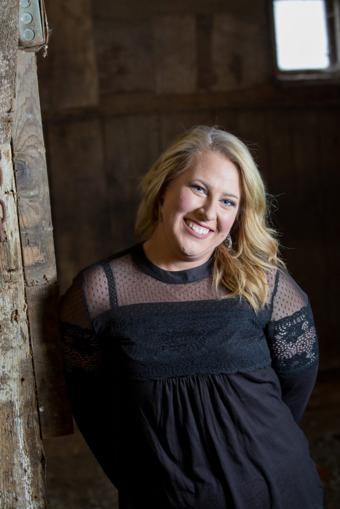 woman posing during rustic engagement session at The Barn at Conneaut Creek